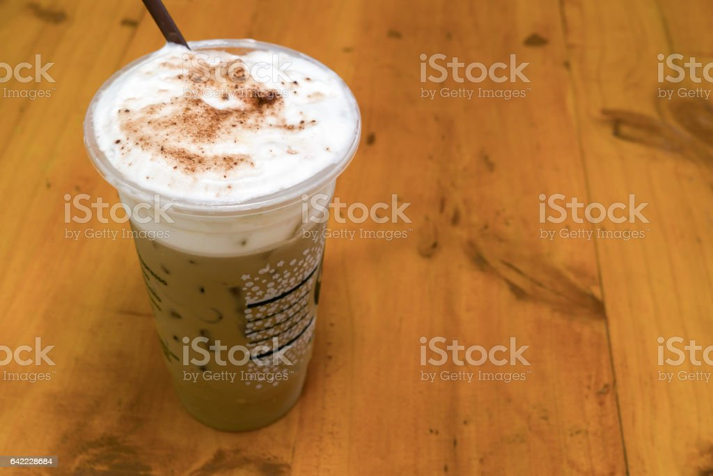 Milk foam and chocolate powder topping on ice coffee. stock photo