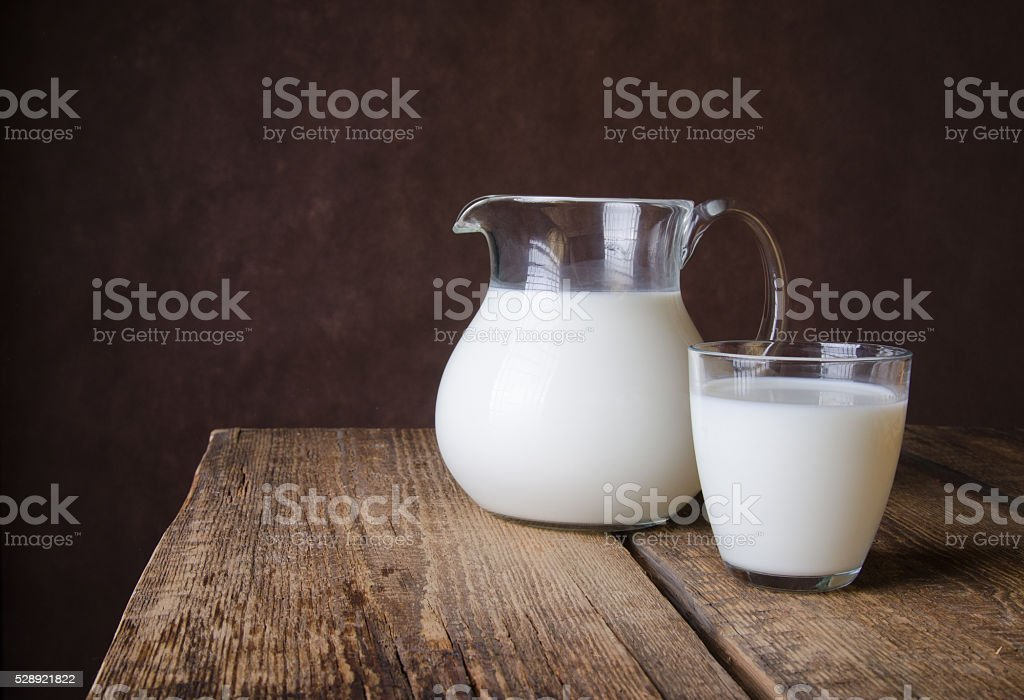 Milk in a glass jug stock photo