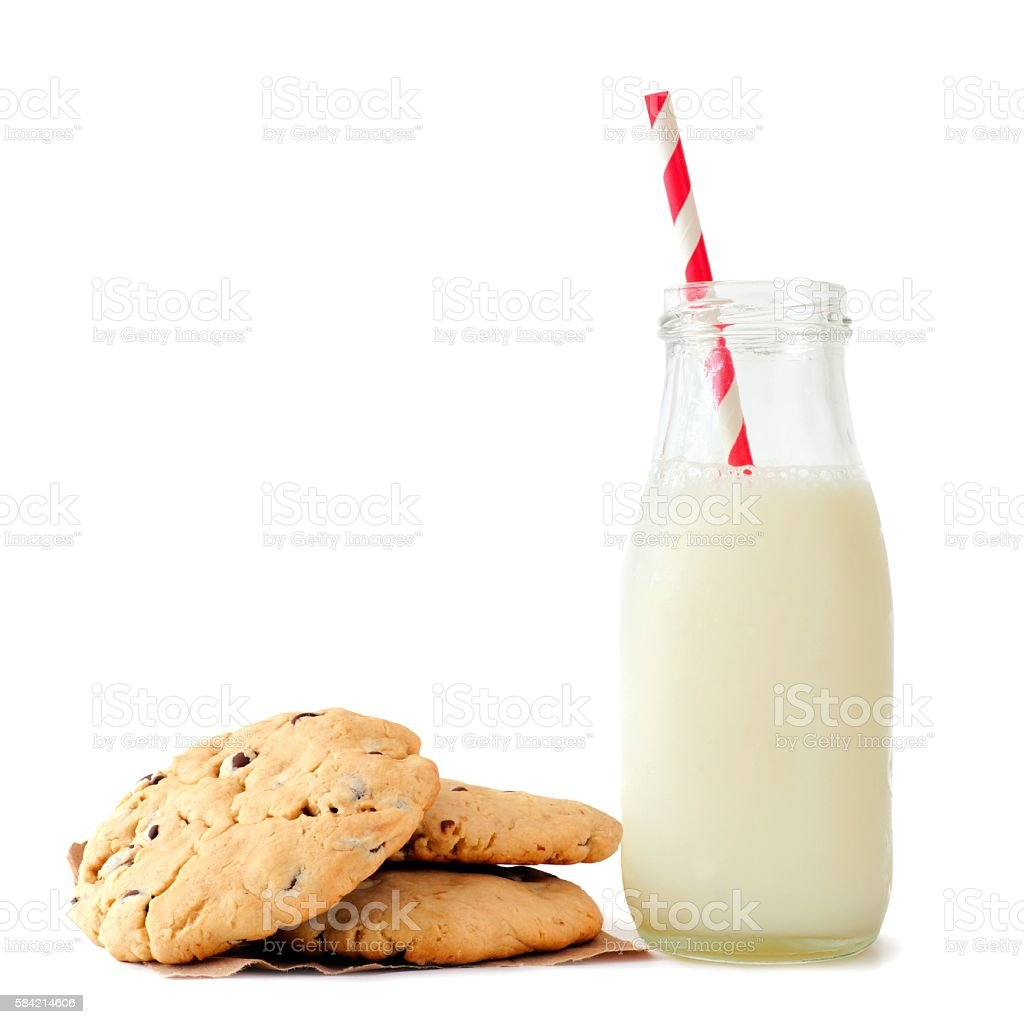 Milk in bottle with chocolate chip cookies isolated on white stock photo