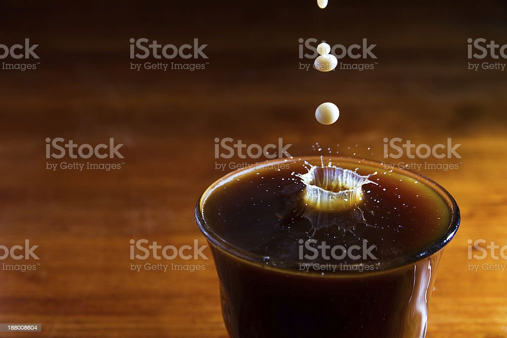 Milk in cup of coffee royalty-free stock photo