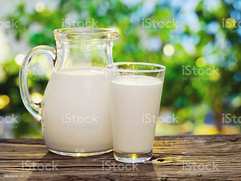 Milk in jar and glass. stock photo