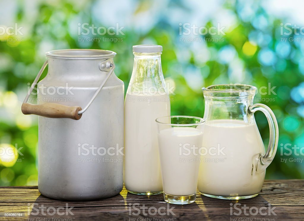 Milk in various dishes. stock photo