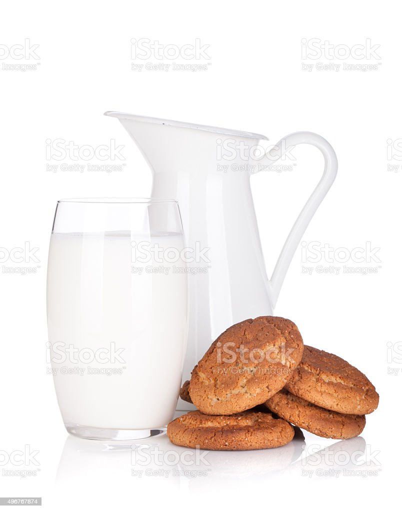Milk jug, glass and cookies stock photo