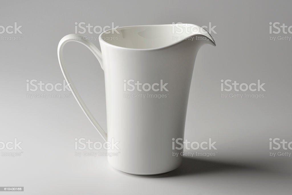 Milk jug of white porcelain stock photo