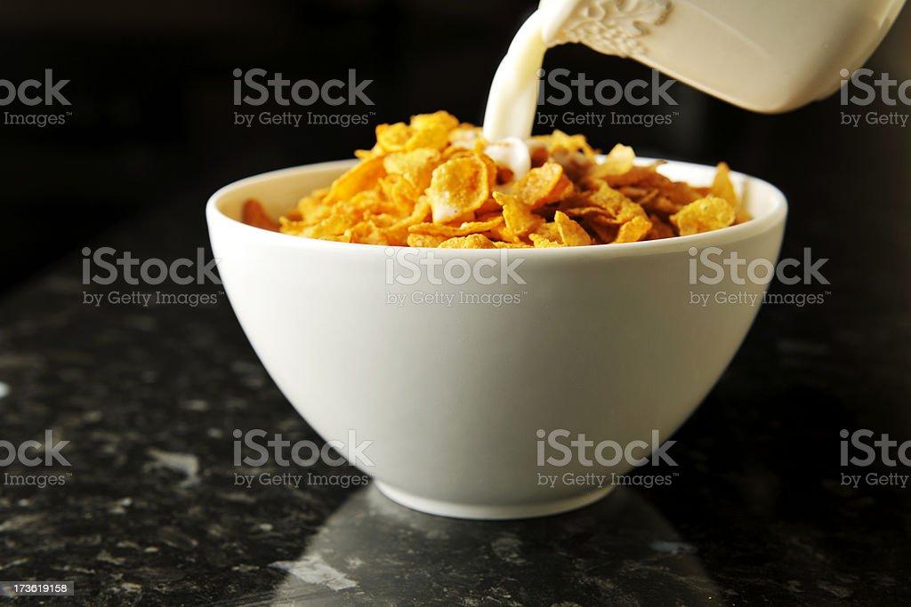 milk poured on cornflakes royalty-free stock photo