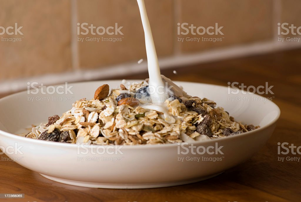 Milk Pouring Onto Cereal royalty-free stock photo