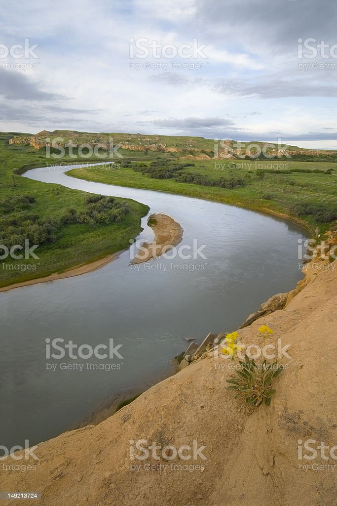 milk river winding through prairie stock photo