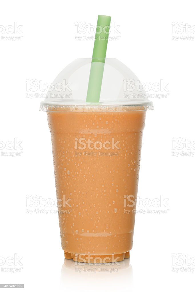 Milk shake with orange fruit stock photo