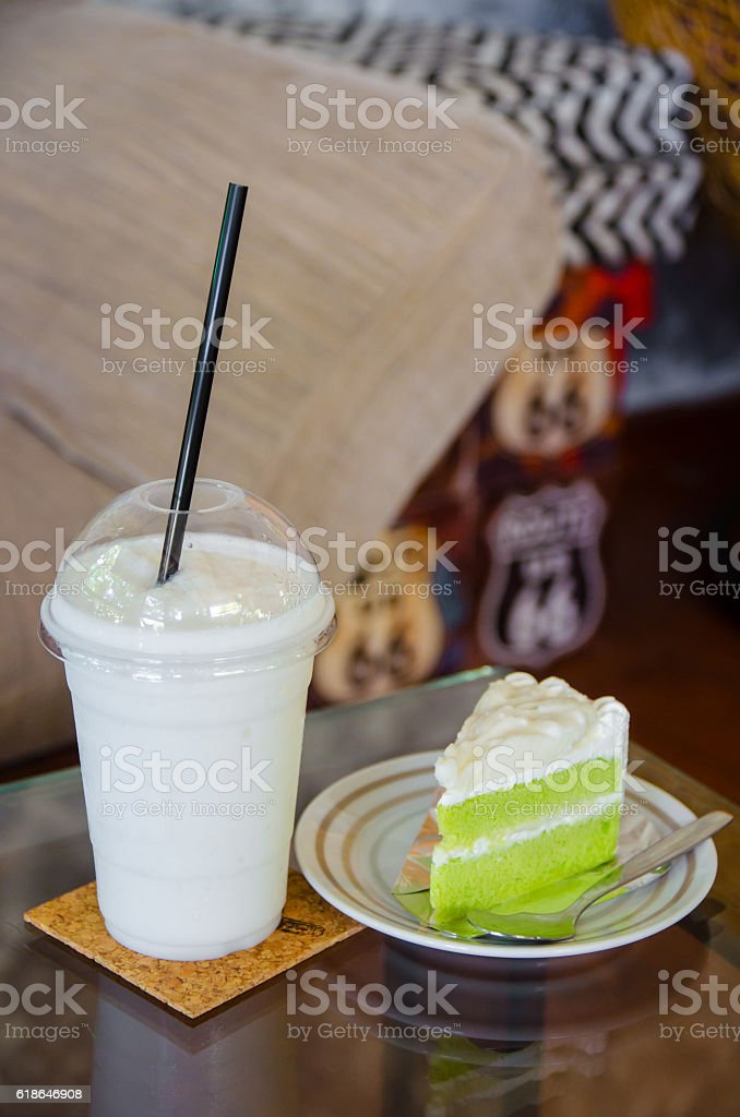 milk smoothie with coconut cake on glass table stock photo