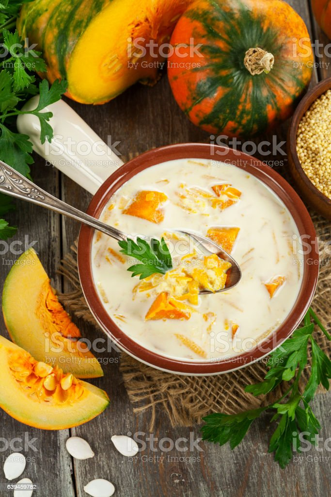 Milk soup with pumpkin and millet stock photo