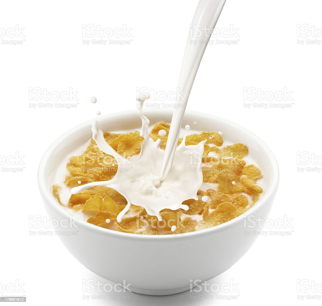 Milk splashing from a height into a bowl of cornflakes stock photo
