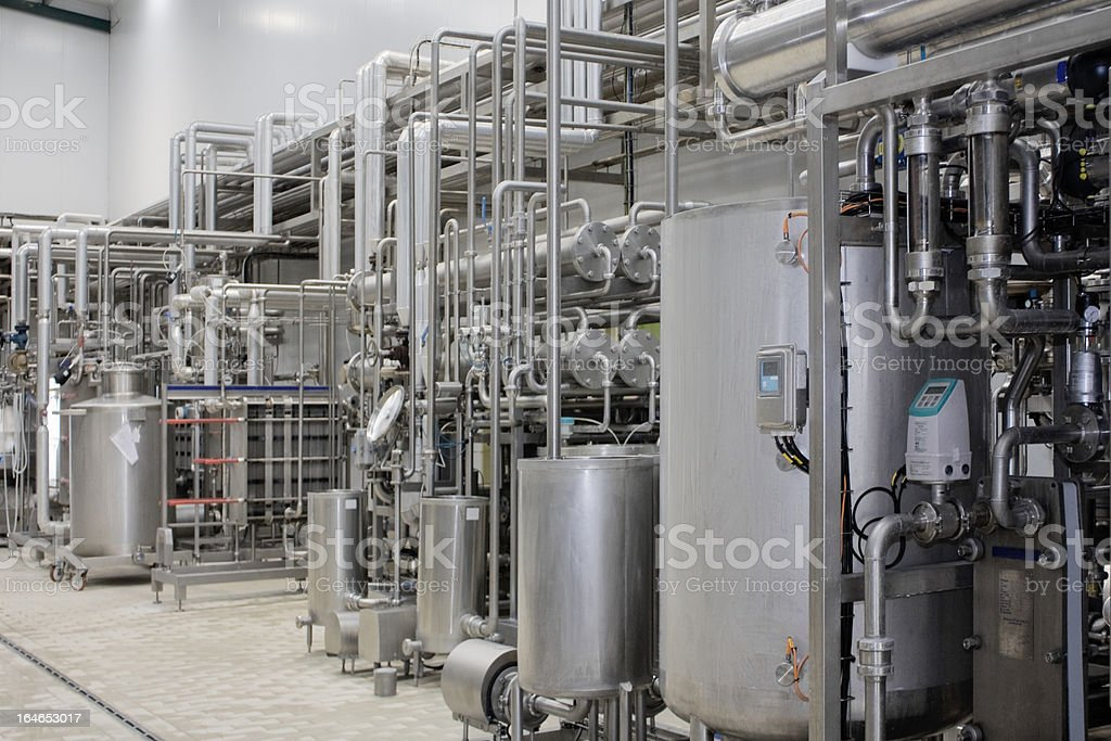 A milk sterilizer machine in a packing plant stock photo