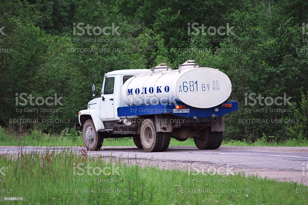 Milk tanker traveling on a rural road stock photo