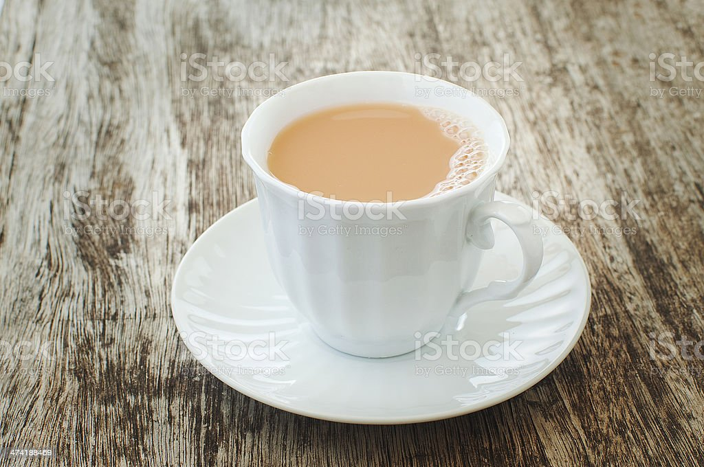 milk tea in a white cup stock photo