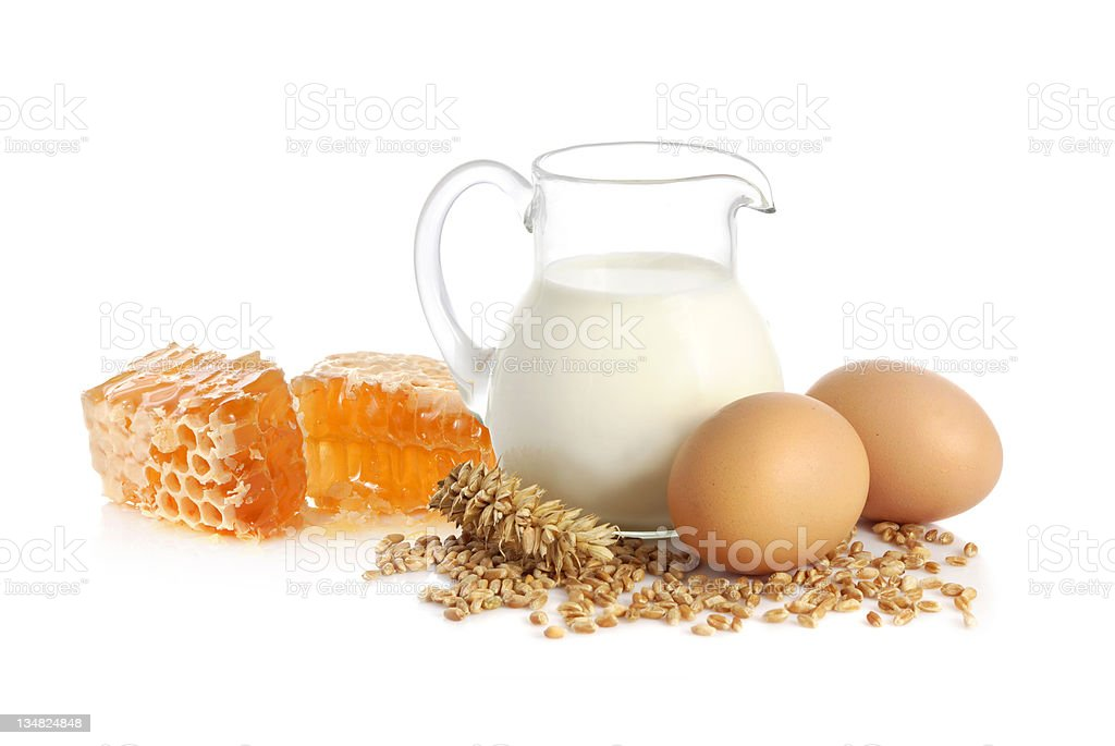 Milk, wheat seeds, eggs and honey royalty-free stock photo