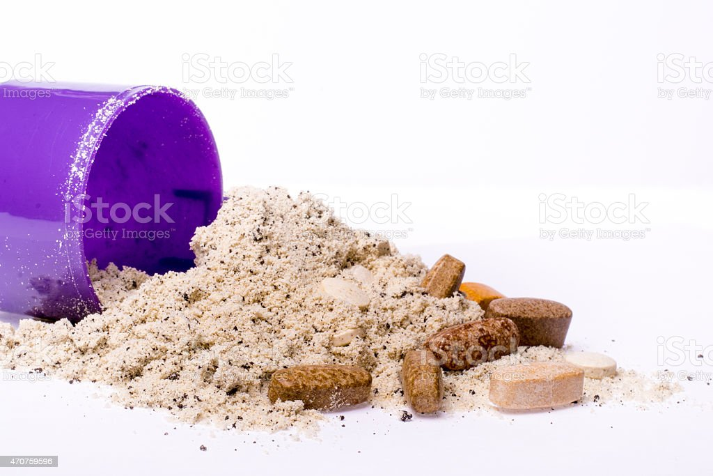Milk whey protein and vitamins for recovery after workouts stock photo