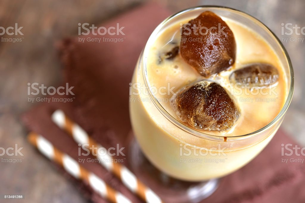 Milk with coffee ice cubes. stock photo
