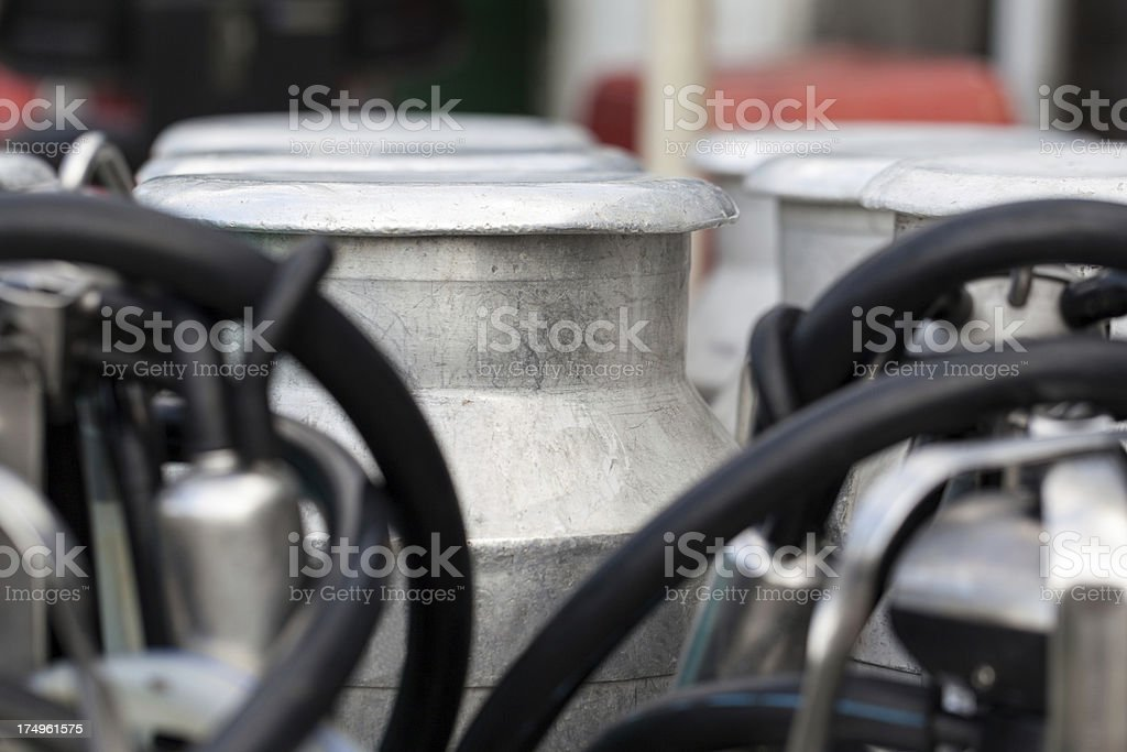 Milking Machine with old Milk Canisters royalty-free stock photo