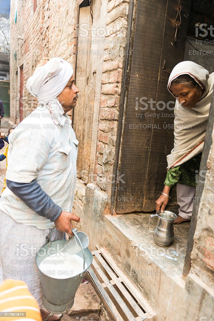 Milkman in the morning in India stock photo