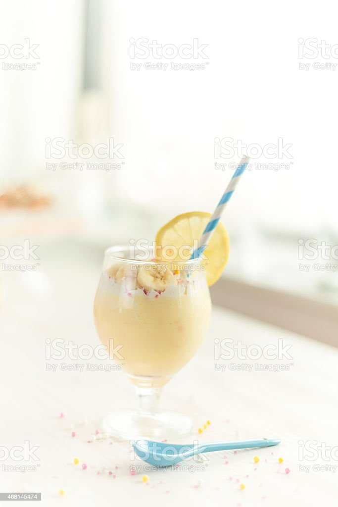 milkshake with banana and lemon flavour and sprinkles stock photo
