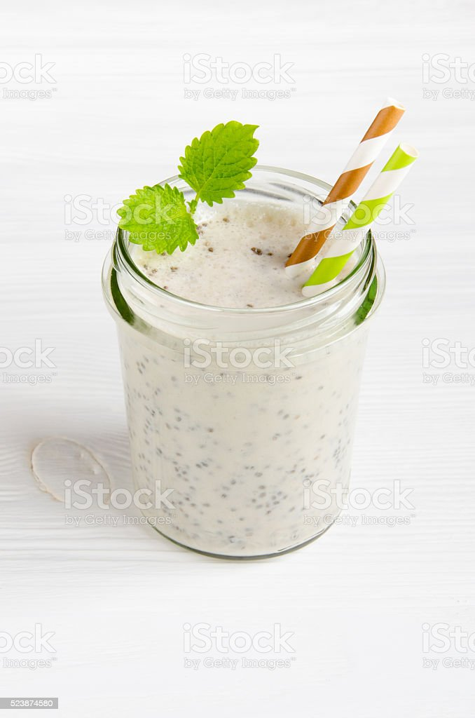 Milkshake with chia seeds in glass jar stock photo