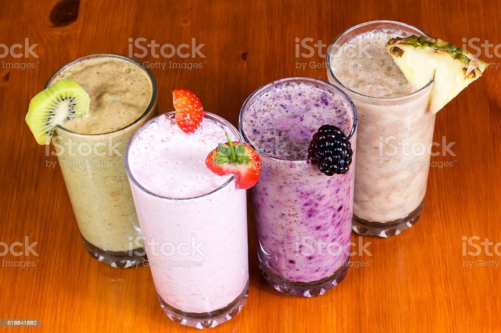 Milkshakes on wooden table stock photo