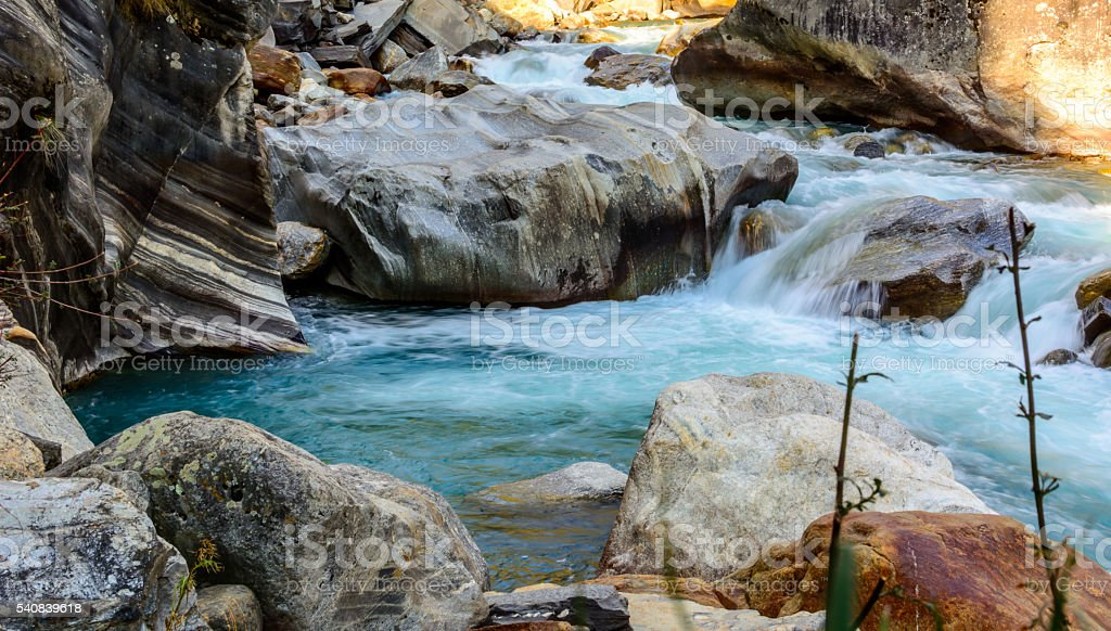 Milky blue glacial water of Parvati River in Himalayas, India stock photo