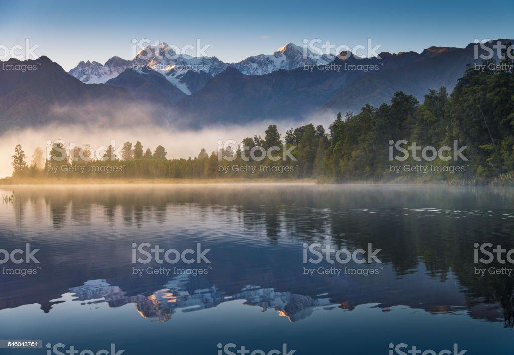 Milky Way Above Snow Peak Mountain, New Zealand at lake matheson stock photo