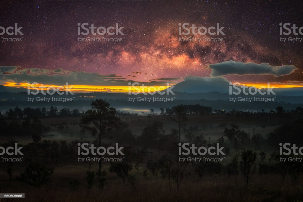 Milky way and fog at Thung Salang Luang National Park at Phetchabun,Thailand stock photo