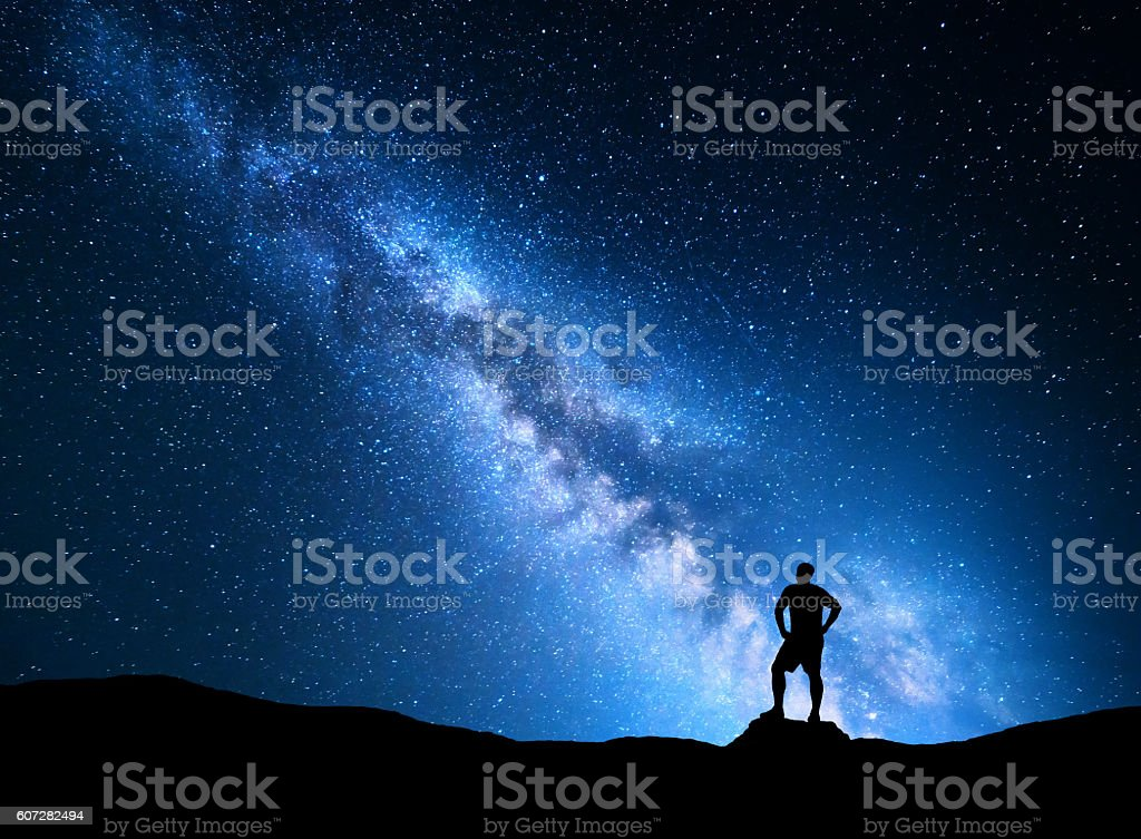 Milky Way and silhouette of a man. Night landscape stock photo