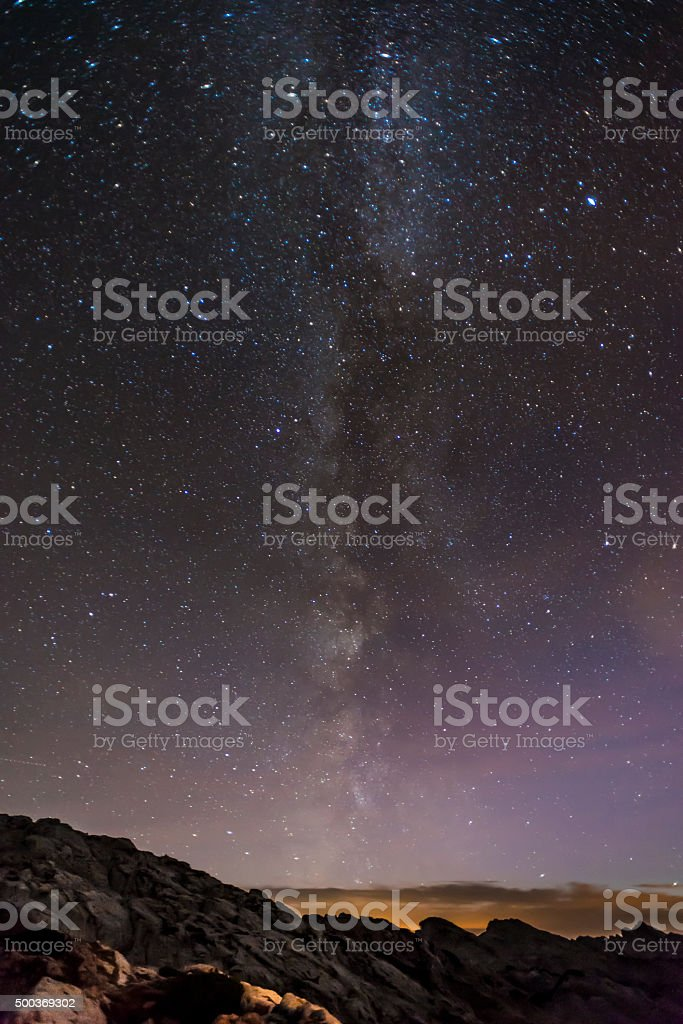 Milky way and stars over Austrian mountains stock photo
