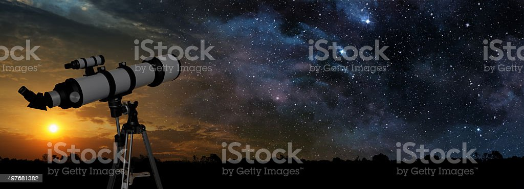 milky way and telescope in the foreground stock photo