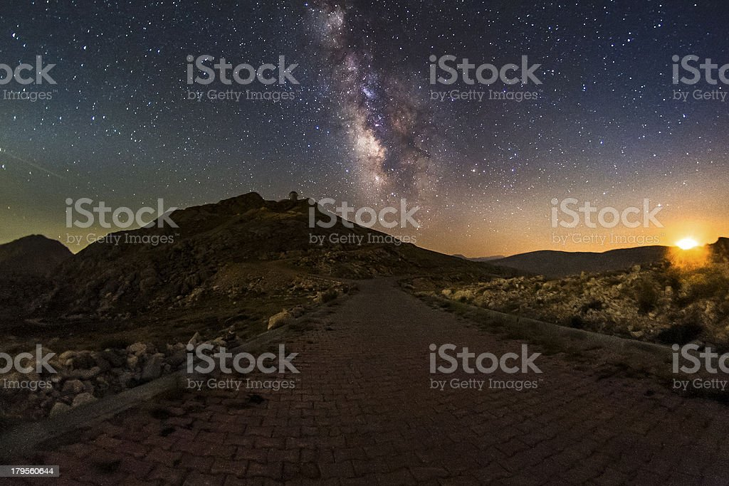 Milky way and the setting moon stock photo