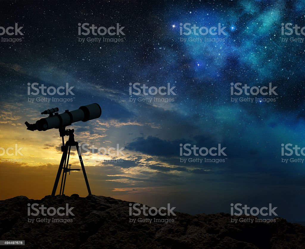 milky way at dawn and silhouette of a telescope stock photo