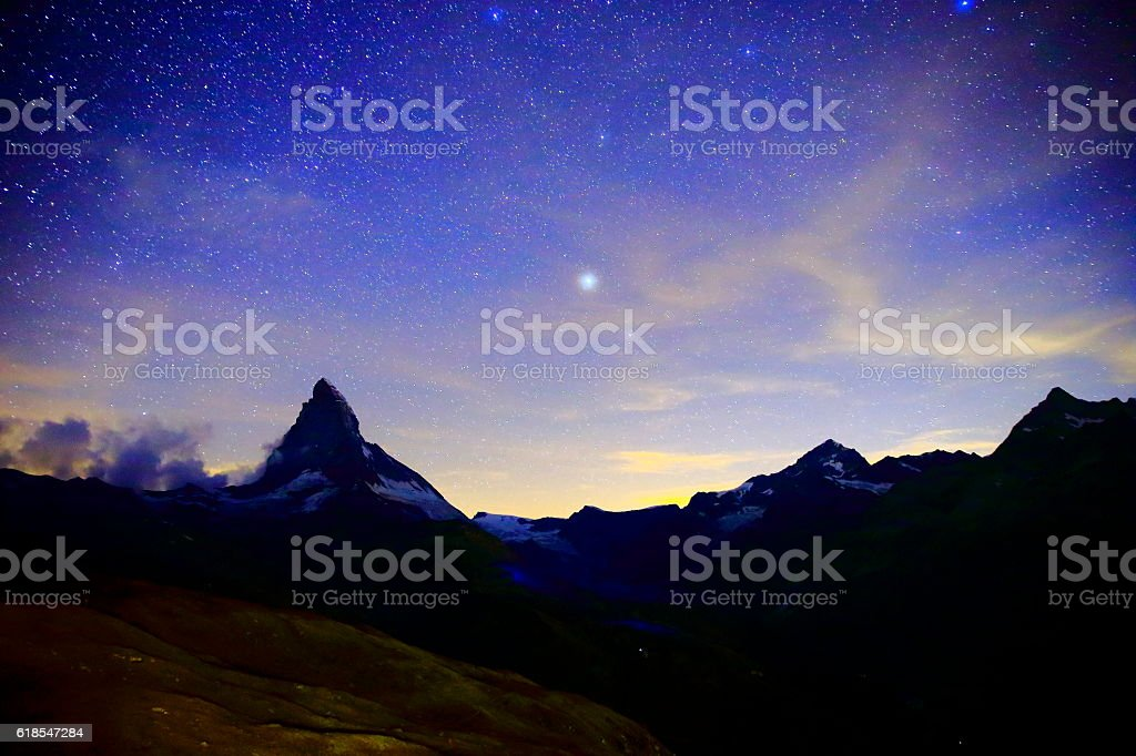Milky Way galaxy above Matterhorn, Swiss Alps landscape at night stock photo