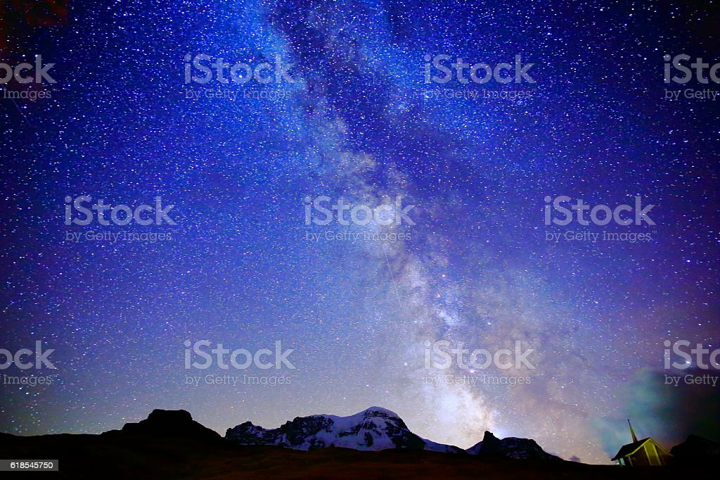 Milky Way galaxy above Monte Rosa, Swiss Alps at night stock photo