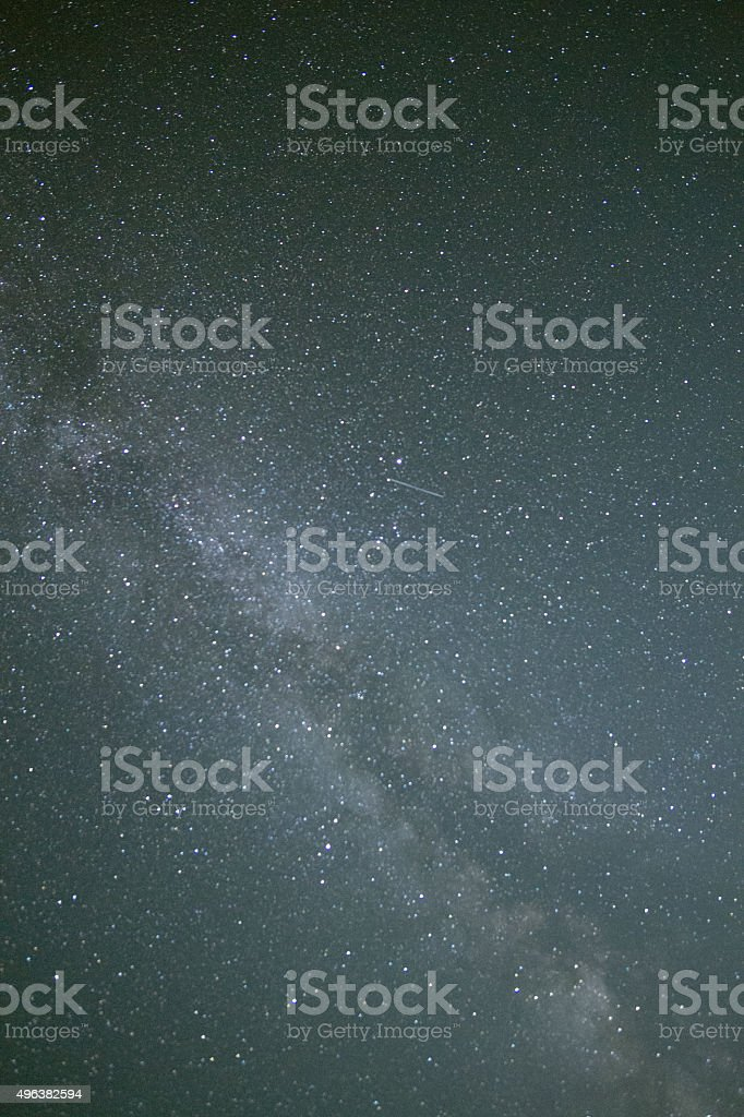 Milky Way Galaxy and meteor in night sky stock photo