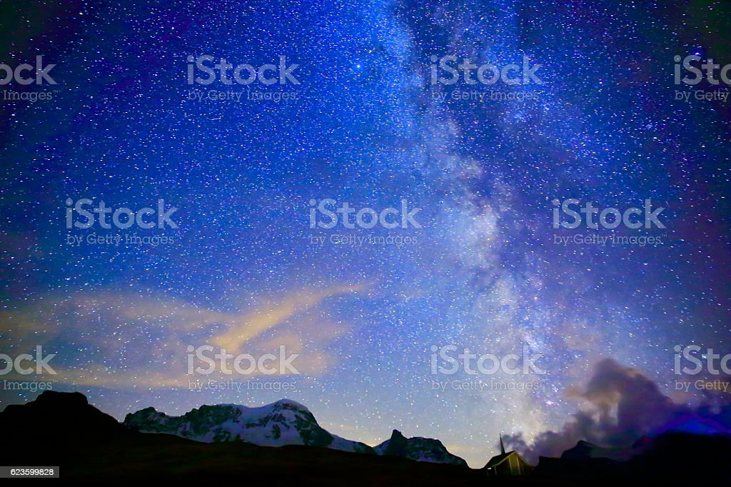 Milky Way galaxy, Monte Rosa, Chapel, Swiss Alps landscape night stock photo