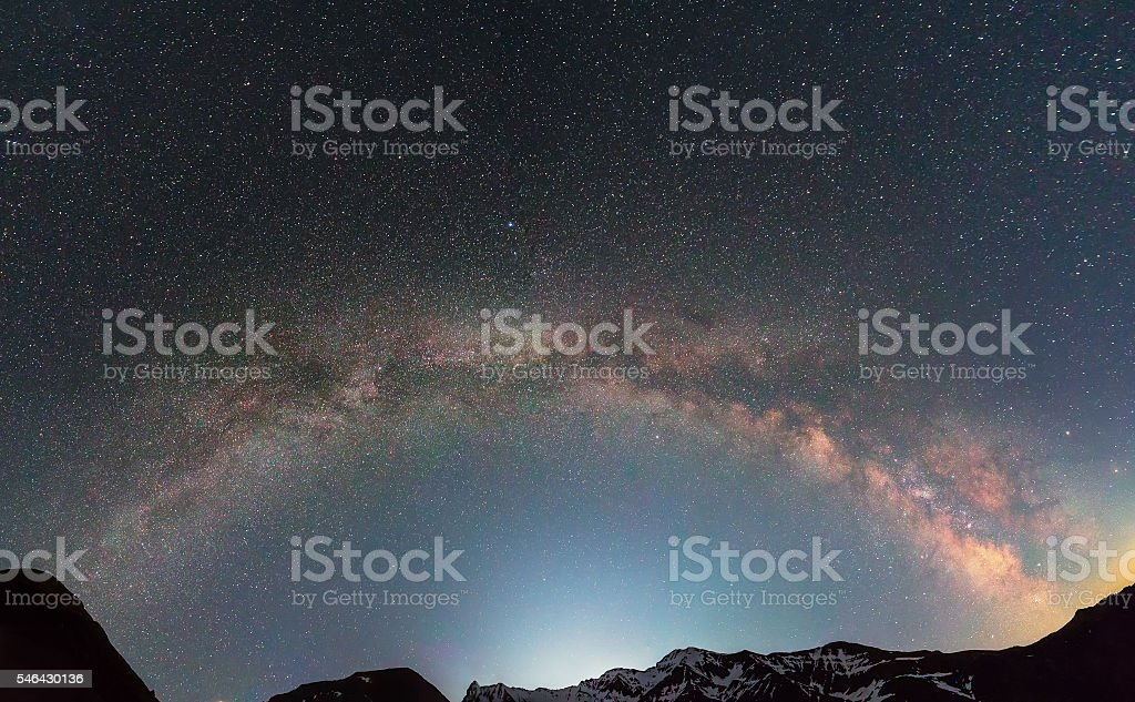 Milky Way galaxy over mountains stock photo