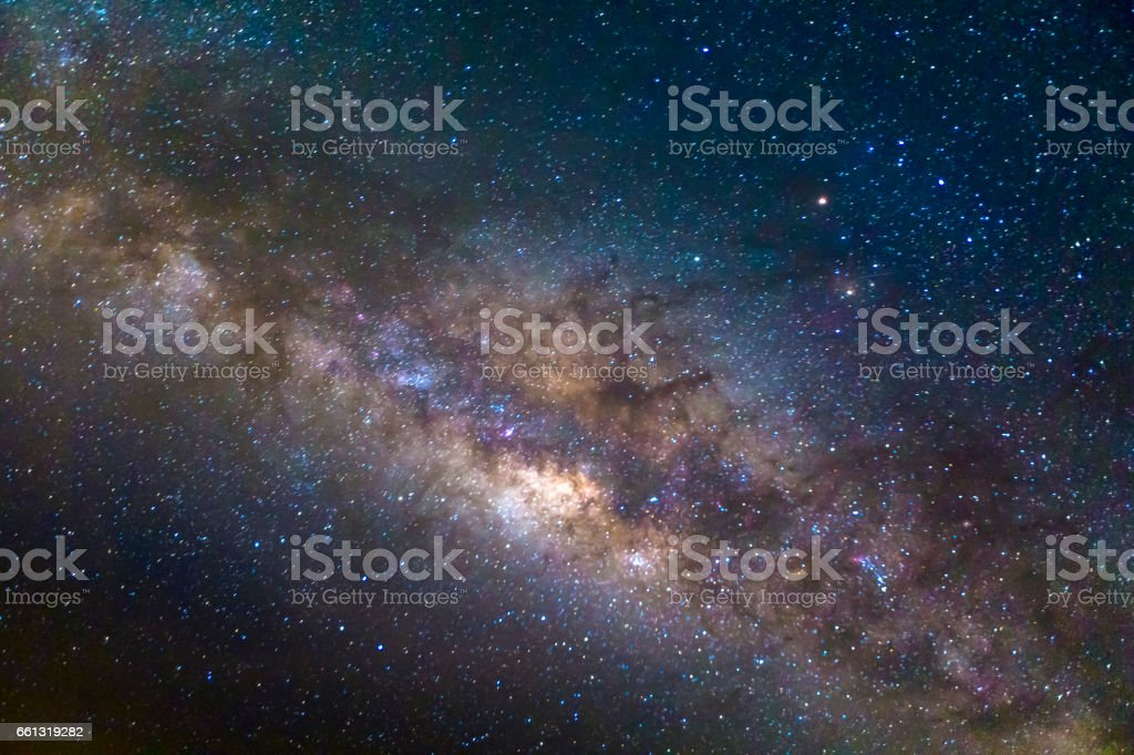 Milky way galaxy with stars and space dust in the universe, Long exposure photograph. with grain stock photo