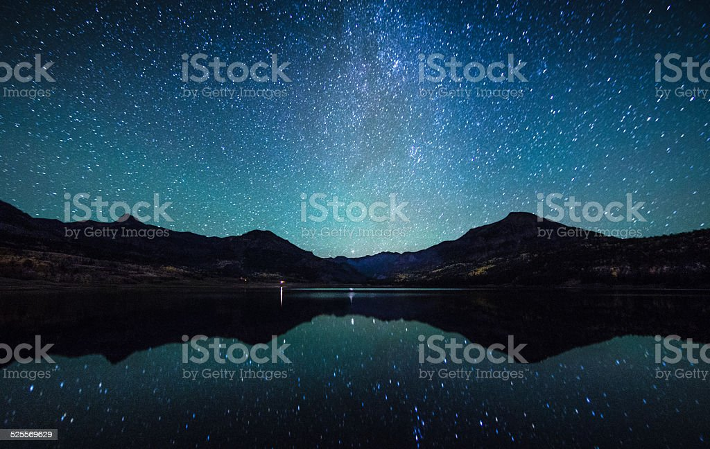 Milky way in the sky with Silhouette mountain. stock photo