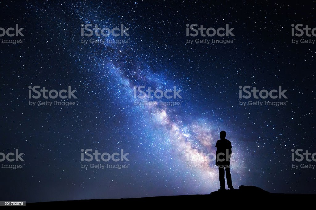 Milky Way. Night sky and silhouette of a man stock photo