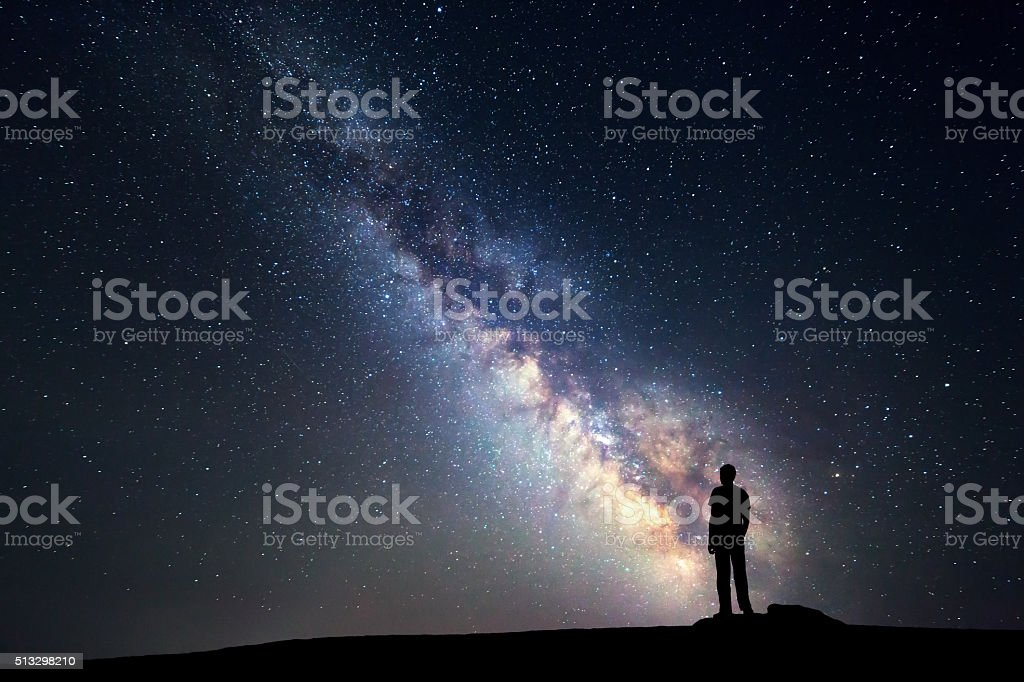 Milky Way. Night sky and silhouette of a standing man stock photo