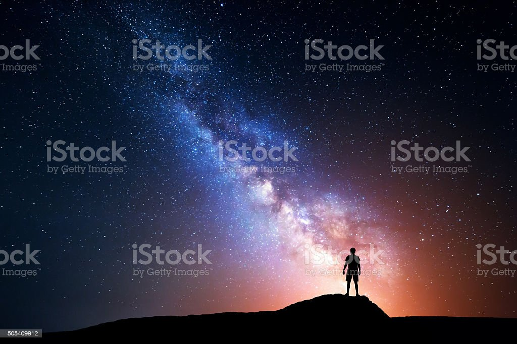 Milky Way. Night sky with stars and silhouette of man stock photo