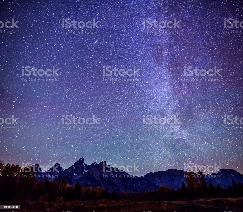 Milky way over Grand Teton Mountain Range stock photo