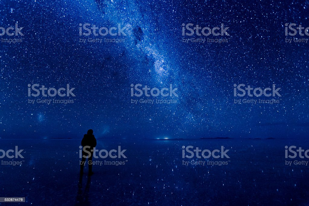 Milky way reflected on the water at Uyuni. stock photo