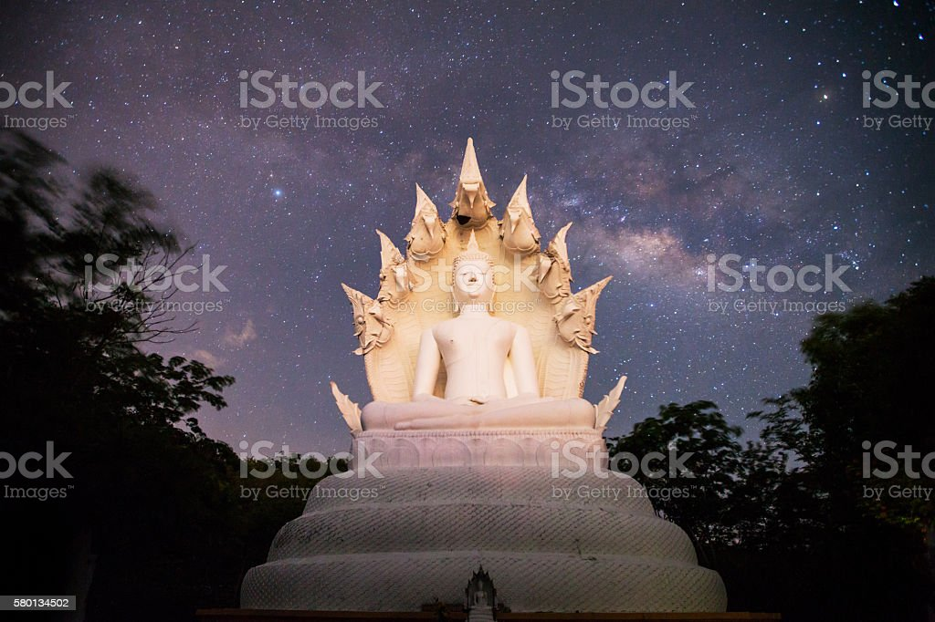 Milky Way rises over the big buddha in Lampang Thailand. stock photo