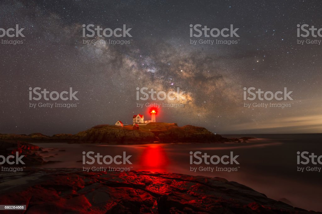 Milky Way rising over Nubble Lighthouse in Maine stock photo