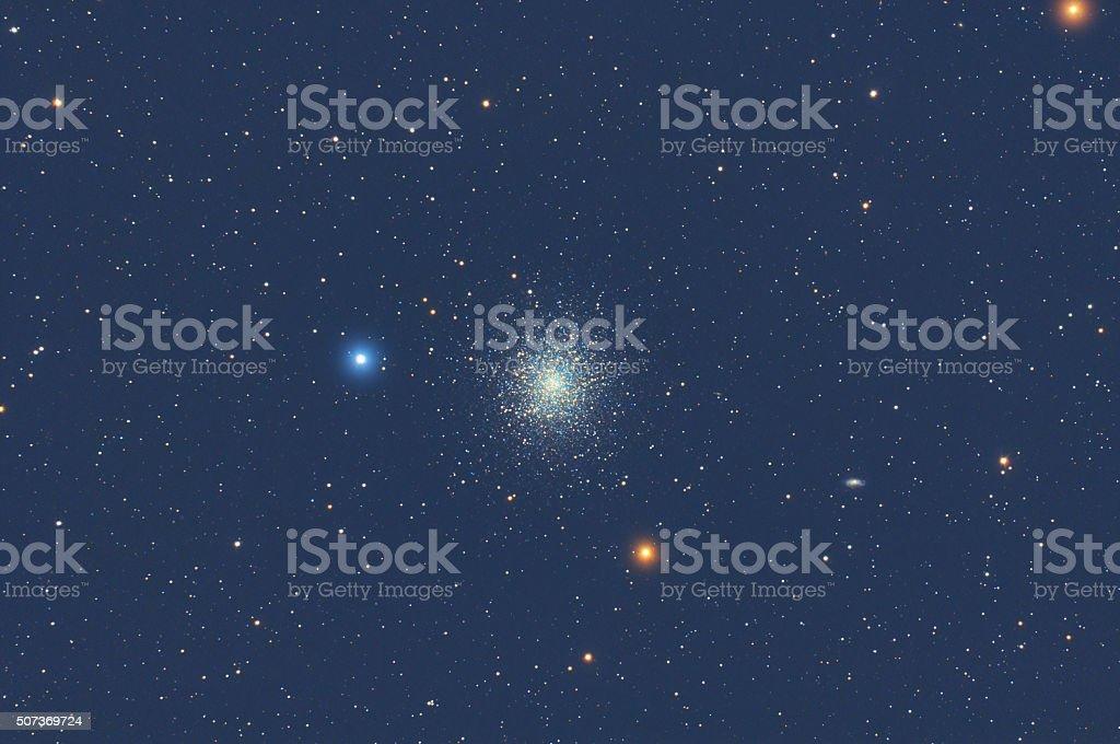 Milky Way stars and globular cluster M13. stock photo