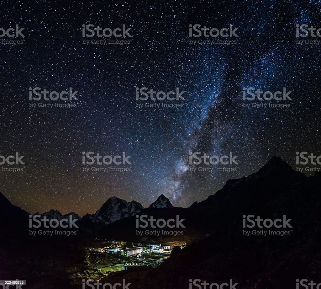 Milky way stars shining over Sherpa village Himalaya mountains Nepal stock photo